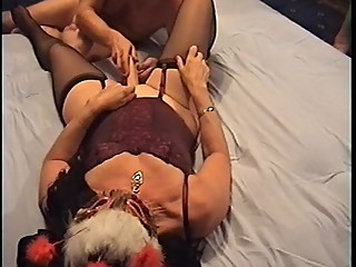 Old man plays with a dildo in wife's pussy